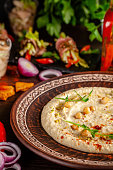 istock The concept of Arabic cuisine. Oriental hummus with grilled sesame and pistachios. Laid arabic table for the holiday. Background image. Top view, copy space 1130952608