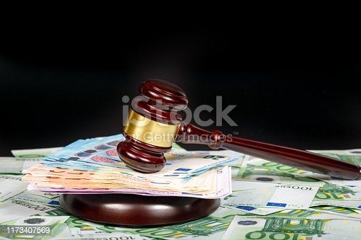 The concept of bankruptcy as the result of bribes.The judicial hammer on banknotes of euros.