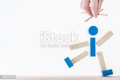 istock The concept of business manipulating, control of people, hypnosis. Abstract man marionette controlled hand, hidden manipulating. 932376610