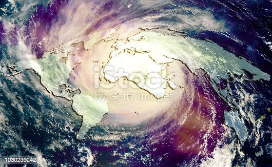 The concept of catastrophic climate change, Huge global hurricane on the background of the world map. Collage using elements furnished by Nasa.