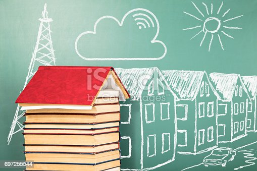 istock The concept of distance education with books and chalk drawing 697255544