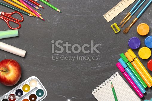 istock The concept of education. Back to school. Stationery on the background of black boards. Copy Space. Flat lay. 1147379591