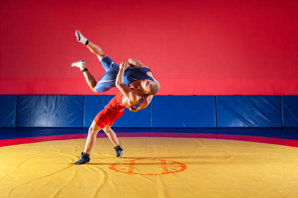 the concept of fair wrestling - wrestling stock pictures, royalty-free photos & images