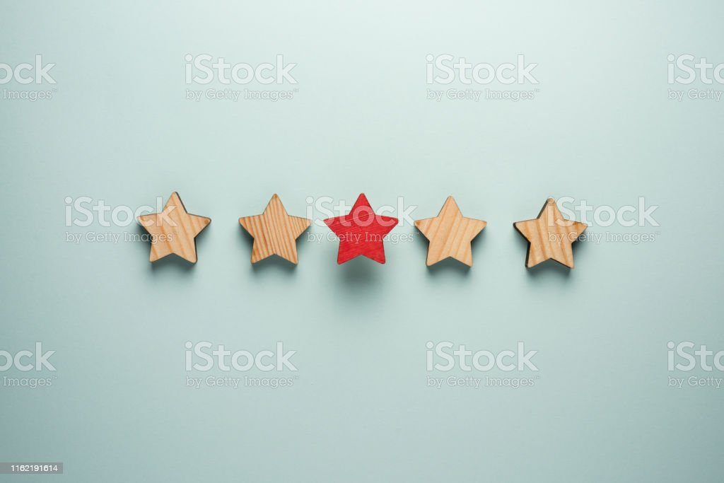 The concept of feedback of five stars. One red star in addition to...
