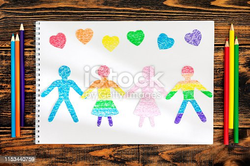 istock The concept of friendship. Paper doll people cut from paper. 1153440759