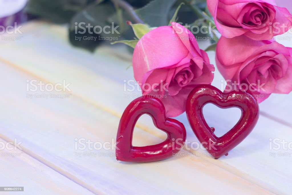 The concept of holidays with pink roses stock photo