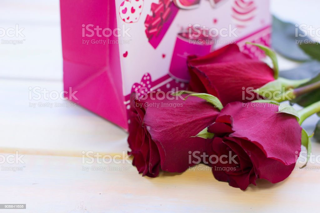 The concept of holidays with red velvet roses stock photo