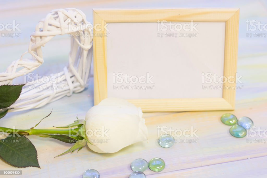 The concept of holidays with roses and photo frame stock photo
