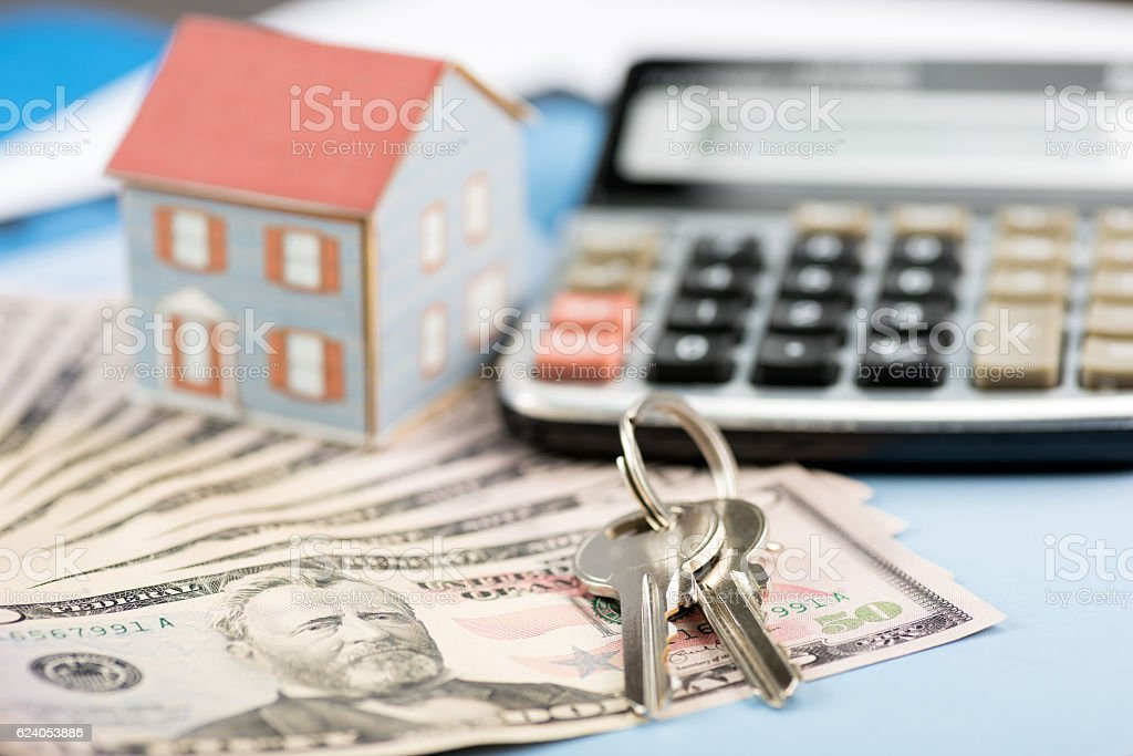 The concept of home ownership and 50 dollars stock photo