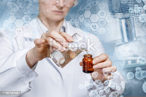 The concept of laboratory studies and experiments. Worker pours the liquid into the tube.