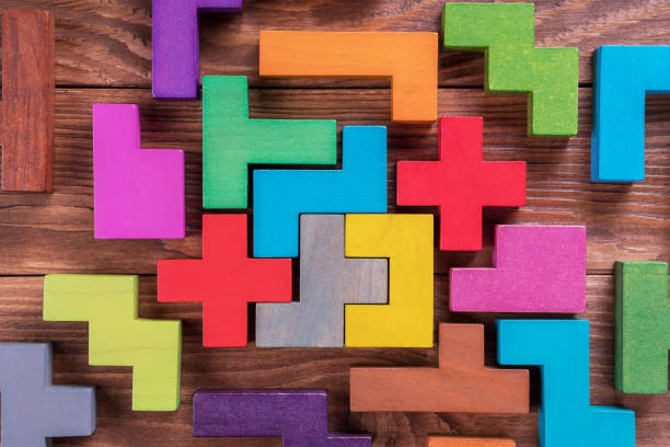 The concept of logical thinking. Geometric shapes on a wooden background. stock photo