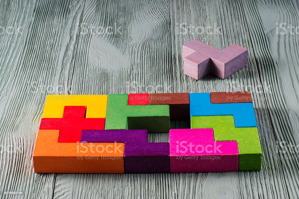 The concept of logical thinking. Wooden geometric shapes. stock photo