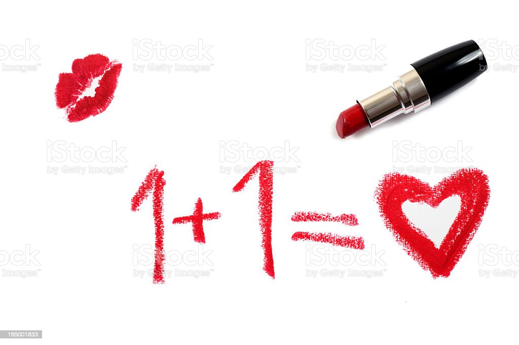 The concept of love written in pink lipstick with a kiss stock photo