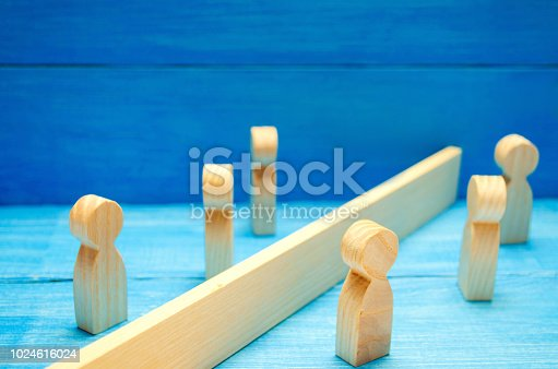 istock The concept of misunderstanding a barrier in relations denial of society. Barriers between people prejudice. social classes 1024616024