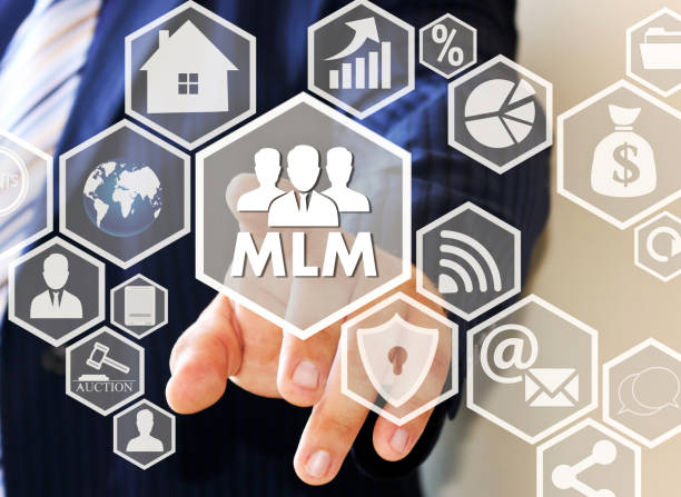 The concept of multi-level marketing. The businessman clicks the button MLM on the touch screen stock photo