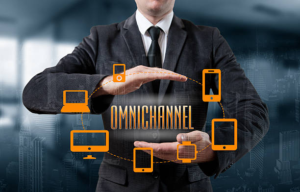 the concept of omnichannel between devices - omnichannel marketing stock photos and pictures
