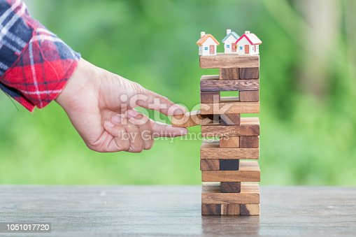 istock The concept of risk of investing money. security of property rights. protection of investments and deposits. family, home. 1051017720