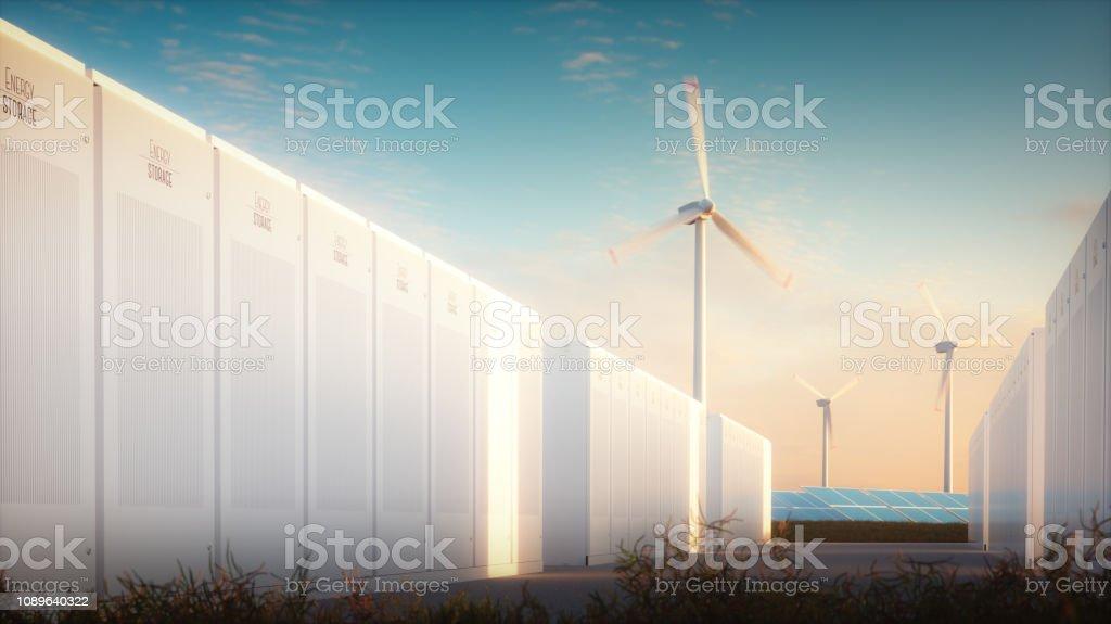 Das Konzept der Einsparung von Energie aus erneuerbaren Quellen. 3D Abbildung eines modernen Akku-Systems mit einem Hintergrund von Solar-Wind-Windkraftanlagen im warmen Abendlicht. – Foto
