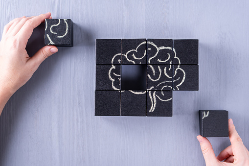 istock The concept of the human brain. Education, science and medical concept.  Brain drawn in chalk on black cubes. 1129860760