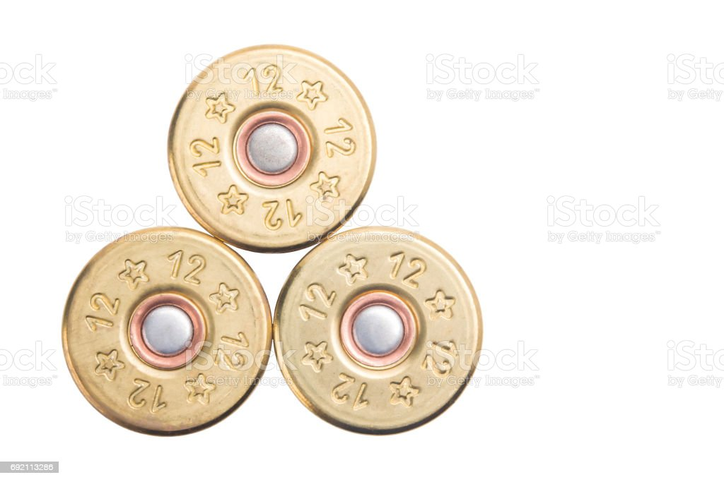 the concept of the three bullets of the 12th caliber for hunting rifles isolated on a white background stock photo