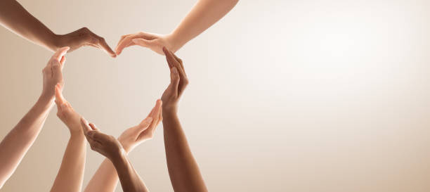 The concept of unity, cooperation, teamwork and charity. Symbol and shape of heart created from hands.The concept of unity, cooperation, partnership, teamwork and charity. amor stock pictures, royalty-free photos & images