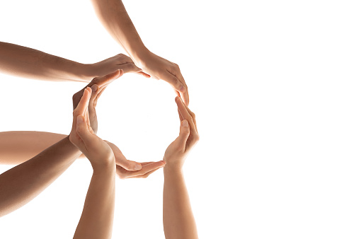 Symbol and shape of circle created from hands.The concept of unity, cooperation, partnership, teamwork and charity.