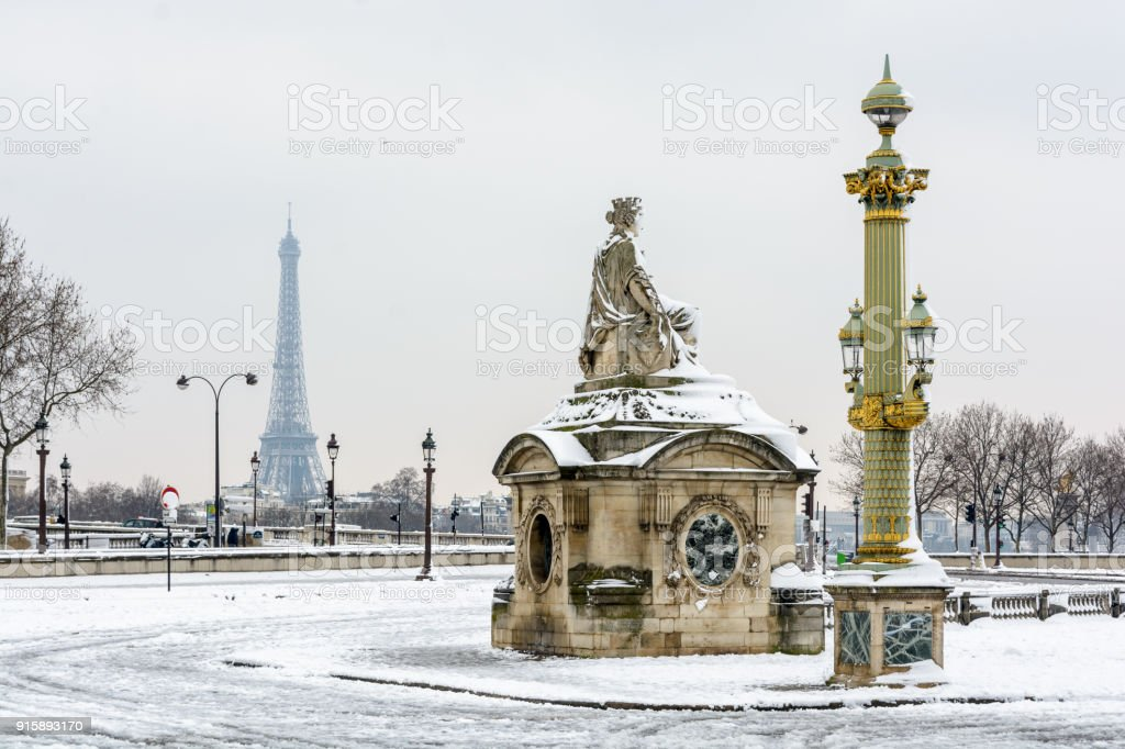 The concorde place by a rare snowy day in paris with the statue