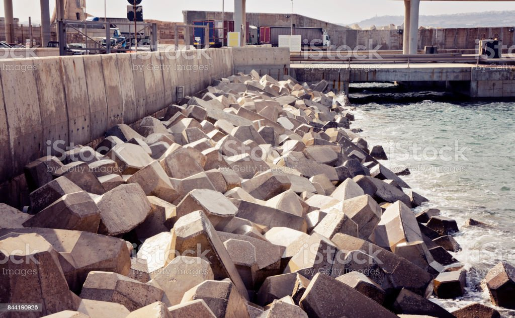 The concrete stones on the shore in the port stock photo