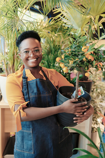 Confident African American Female Flower Shop Owner Smiling and Looking at the Camera