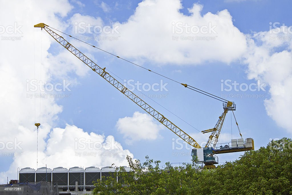 The construction crane on day with sky stock photo