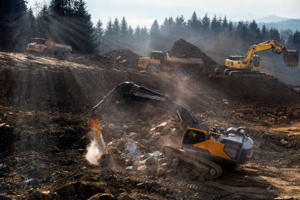 the construction machinery  prepare the ground for the construction of highway s7, naprawa, poland - land vehicle stock photos and pictures