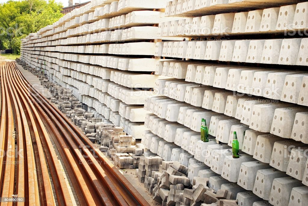 The construction of a railway line for a tram with rails gravel and underlay sleepers stock photo