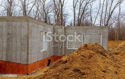 The construction site of a new home poured foundation of concrete construction works