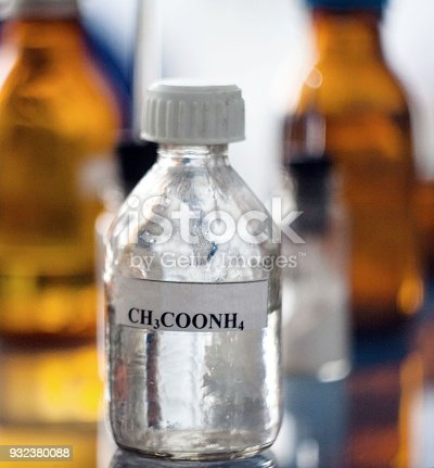 The container of chemical substance ammonium acetate. Photo.