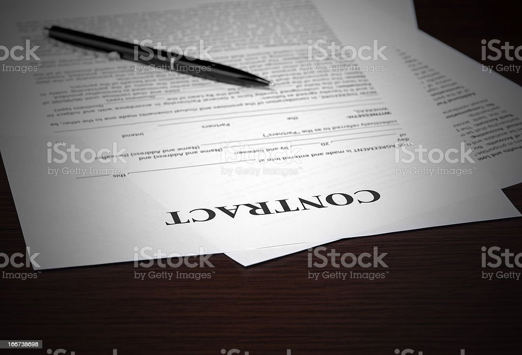 The contract on desktop royalty-free stock photo