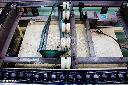 istock The conveyor chain, and Conveyor belt damaged. 802907400