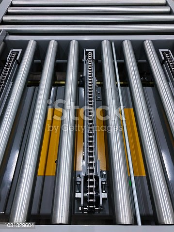 istock The conveyor chain, and conveyor belt is on production line in clean room. 1031329604