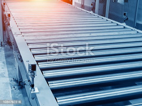 istock The conveyor chain, and conveyor belt is on production line in clean room. 1034762316