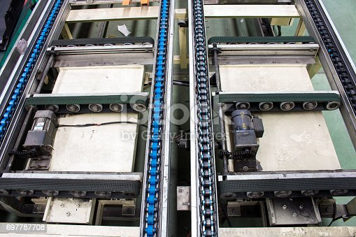 istock The conveyor chain, and conveyor belt is on production line. 697787708