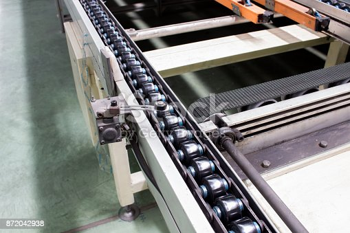 istock The conveyor chain, and conveyor belt is on production line. 872042938