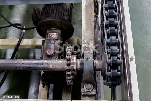 istock The conveyor chain drive shaft in industry. 821537080