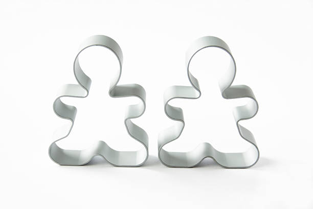 """The Cookie Cutter Couple """"Two cookie cutters, isolated on white."""" cookie cutter stock pictures, royalty-free photos & images"""