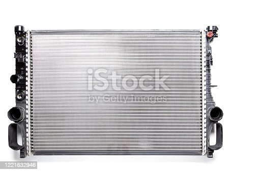 istock The cooling radiator is a metal heat exchanger inside filled with antifreeze. Rubber pipes are connected to it, which are mounted on the corresponding neck of the motor. Repair in the workshop. 1221632946