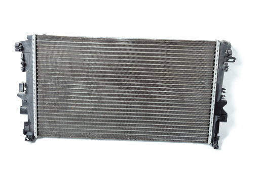 istock The cooling radiator is a metal heat exchanger inside filled with antifreeze. Repair in the workshop. Parts Catalog. 1257396434