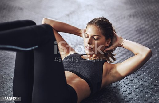 Shot of a young woman working out at the gymhttp://195.154.178.81/DATA/i_collage/pi/shoots/806022.jpg