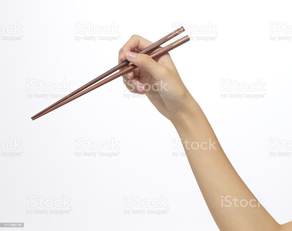 The correct way of holding chopsticks stock photo