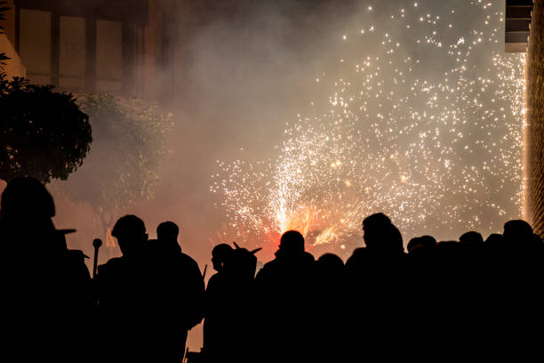 The correfocs is a typical Catalan celebration in which dragons with fireworks dance through the streets. stock photo