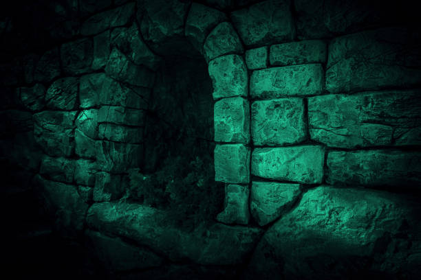 the corridor is horror, scary, darkness. ghostly gloomy cave in the castle, alcove in the tunnel, entrance to the basement in the mystical night light of the moon with eerie strange shadows - crypt stock pictures, royalty-free photos & images