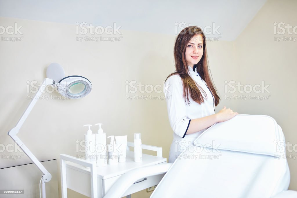 The cosmetologist is caring for the patient's face royalty-free stock photo