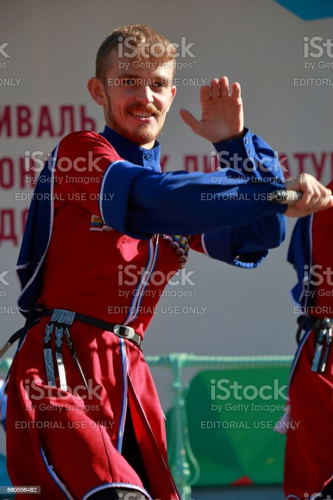 The Cossack dance with sabers in traditional clothes stock photo